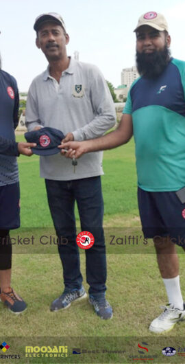 Captain & Vice Captain presenting souvenir to Mr. Fakharuddin Baloch